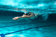 Swimmer in a lane of the pool swimming adult lenghts.
