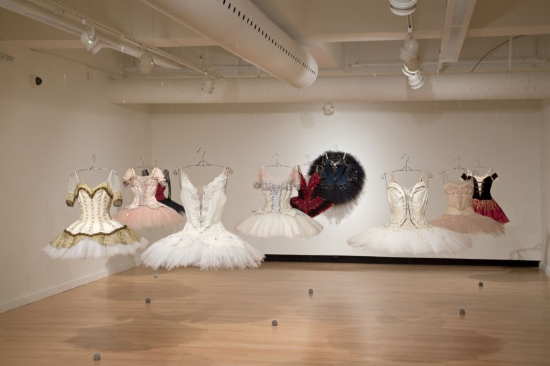 Art Gallery space with ballerina costumes hanging from the ceiling