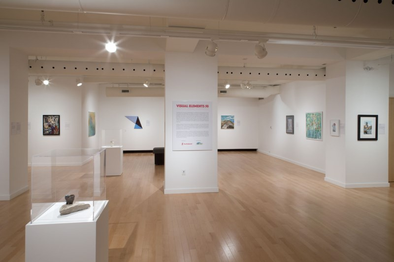 Art gallery space with artwork hanging on the walls